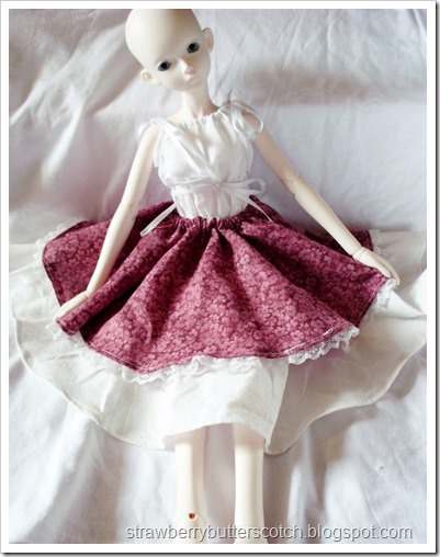 Bjd in a red and off white layered circle skirt