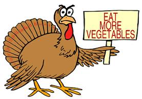 Turkey holds sign Eat more vegetables