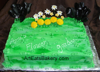 Flower garden birthday cake with daisies, marigolds, daffodils and black elephant ears