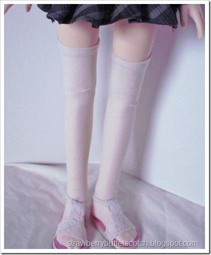 Thigh high socks for dolls.