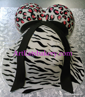 Zebra and cheetah print black, pink and white baby bump baby shower cake design