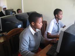 photo of kids using computers