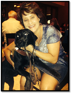 Theresa Montano,  Solutions Architect of Accessibility PMP, CSM and her guide dog Thyme.