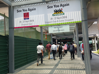 Signs at Singapore Expo invited delegates to visit again in 2018.