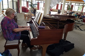 Kay Boyes playing the Steinway grand piano.