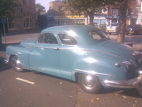 large light blue '40's American car