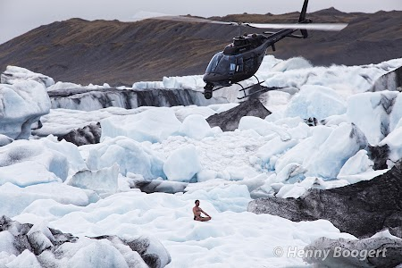 Wim Hof meditating in Iceland, preparing for a dive into the extremely cold water.