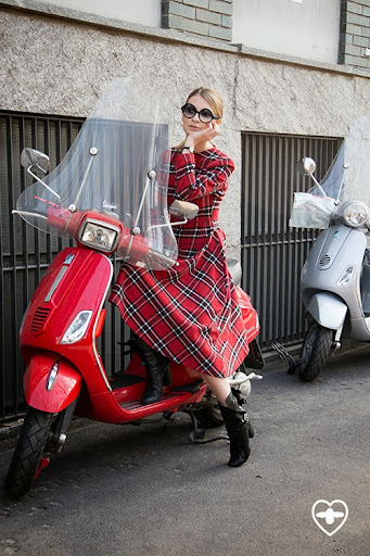 Maria Kolosova; fashion editor; Palini glasses; Sergevi Teblov dress; Laurance Decade boots;
