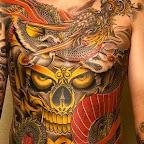tatuagem no peito completo de crânio grande e dragão.jpg