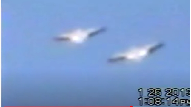 Silver metallic looking Flying Saucer UFOs in formation over Mexico.