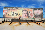 """El Asesino"" Cuban government poster facing the United States Interests Section (located in the Embassy of Switzerland) in Havana. The United States therefore does not strictly speaking have an embassy in Cuba."