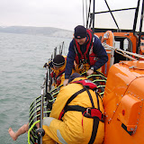 Poole lifeboat crew members rolling the Jason's cradle and casualty onto the relief Tyne class lifeboat David Robinson on exercise on Sunday 20 January 2013 Photo: RNLI Poole/Dave Riley
