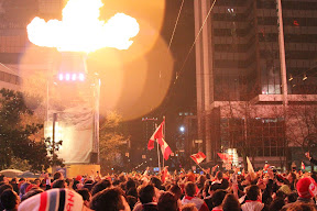 Flames lighting the crowd at one of Robson Square's nightly fireworks celebrations