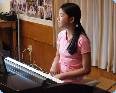 Phoebe Zhang playing the Clavinova CVP-509. Photo courtesy of Dennis Lyons.