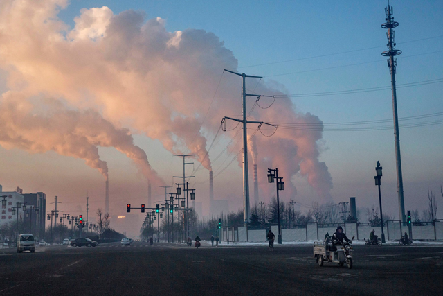 A coal-fired power plant in Shanxi, China, in 2015. The government has canceled 103 coal plants that were planned or under construction, eliminating 120 gigawatts of future coal-fired capacity. Photo: Kevin Frayer / Getty Images