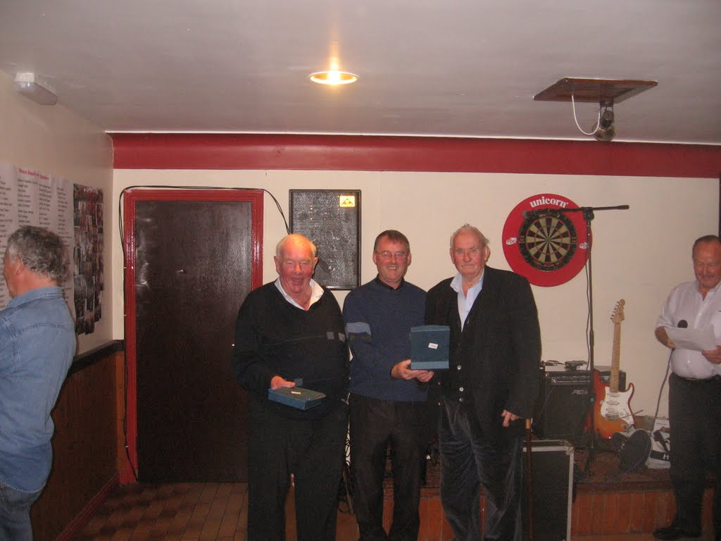 Fr. Michael Gormally presenting awards to long-serving committee members, Martin McLoughlin and Patsy Gallagher.