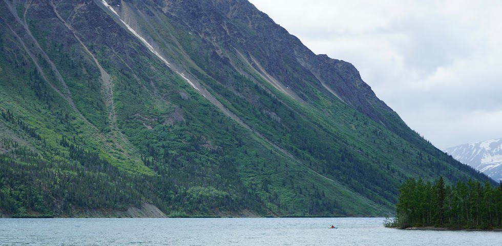 A lone kayaker among the mountains - Yukon Territory, Canada