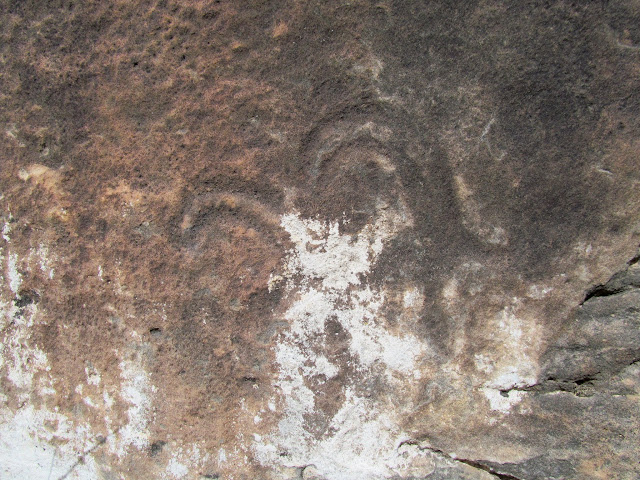 Faint bighorn sheep petroglyphs