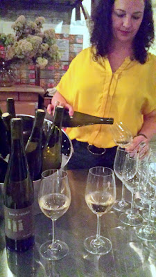 Angela Reat pouring love & squalor wine during the passed appetizers, a 2014 Pinot Gris from Willamette Valley