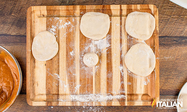 dough rolled out on a cutting board