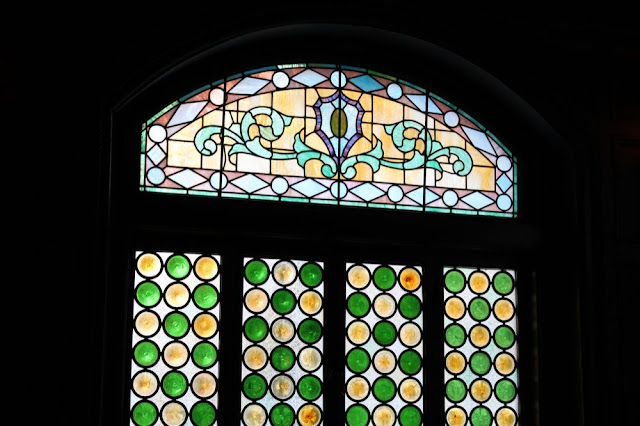 another stained-glass window, this one in green and yellow