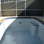 Cracked coping & matted waterline tile with new cap tile