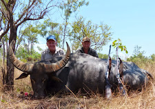 Mr Dennis Brownley, USA with a nice old buffalo from Carmor Plains. Taken one hot midday in November.