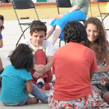 Kevin, Joseph and Rebekah listen while Lianza shares with the kids.