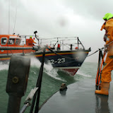 Poole Tyne class lifeboat alongside Swanage Mersey class during an exercise in rough weather - 26 January 2014 Photo: RNLI Poole/Rob Inett