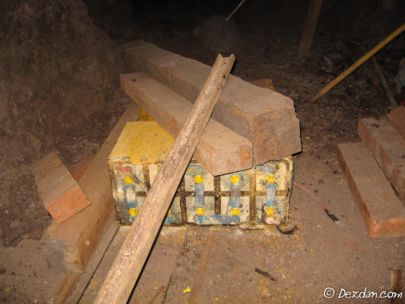 A large battery box off a trammer rest on the floor.