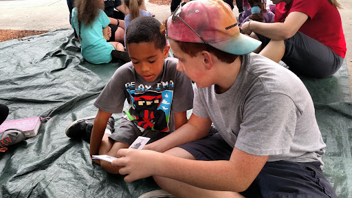 Connor sharing the gospel booklet with one of the kids.