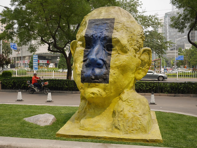 """Yellow Sculpture"" from ""Three For You"" by Gianni Dessi in front of the Parkview Green in Beijing"