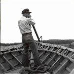 Aleut man rowing dory at KILL.jpg