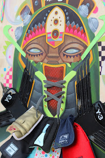 "Fly Ish, Acrylic and spray paint with deconstructed sneaker tongues and sneaker components, 24"" x 36"", $3,500"