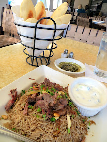 Baltimore Lebanese Taverna Ouzi dish of braised lamb, spiced rice, yogurt sauce