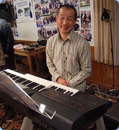 Our guest artist, Taka Iida, playing his two-manual keyboard. Photo courtesy of Dennis Lyons.