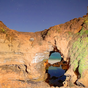 Night time window to the sea by I Snapit - Landscapes Caves & Formations ( natural window, light painting, waterscape, sea caves, stars )