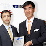 Mr. Zin Young Hong, Executive VP of Hyundai WIA's Machine Tool Division presents a plaque to Jim Palos, President of Humboldt Park Vocational Education Center (HPVEC) of City Colleges of Chicago