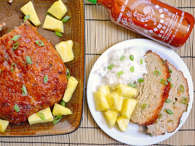 Thai Turkey Meatloaf on pan with two slices and a side of pineapple and rice plated on plate