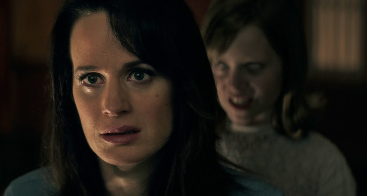 Elizabeth Reaser as Alice and Lulu Wilson as Doris in OUIJA: ORIGIN OF EVIL. (Photo courtesy of Universal Pictures).