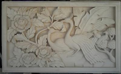 Relief burung merak batu alam paras jogja