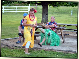 11m1- Hawaiian Luau - May 30 - Let the Games Begin - Howard declared Warrior Chief - one dart to kill the pig
