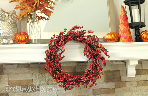 If your mantel shelf is shallow, you can hang a wreath across the front of it, adding depth and drawing the eye towards the center intstead of only above the top of the shelf.