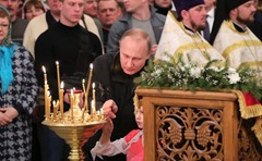 Putin attended Christmas mass at Spassky Cathedral in St George's (Yuriev) Monastery.