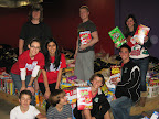 Shown on the final collection day, students participating in the Battle of the Boxes outreach effort include Alyshah Aziz, Tania Joakim, Tim Alletto, Casey Kopp, Nick Mrasek, Kyle Rae, Andrew Emanuel, Jacob Pickle, and Zach Pickle. Photo provided by Christmas Is For Children