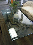 Glass Table with decorative base $249