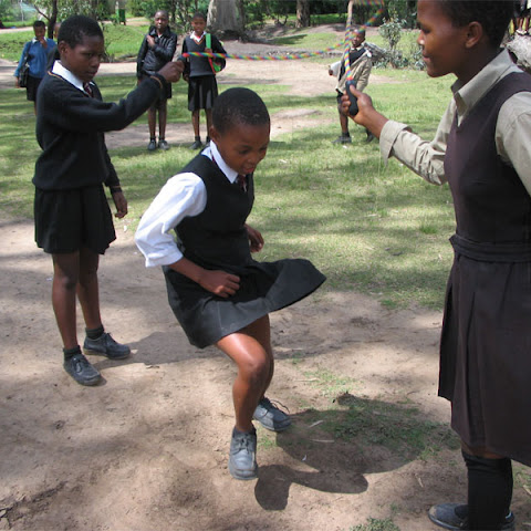 Girls skipping in a Lesotho school playground