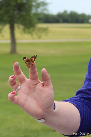 One of the bridesmaids with a butterly
