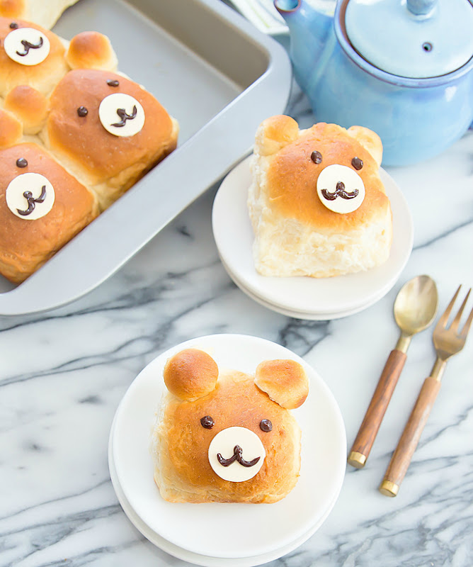top-down photo of bear-shaped rolls on white plates