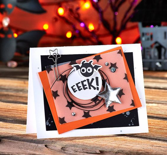 Eeeek! This adorable Halloween card idea features the You're Batty stamp set, plus beautiful printed vellum. Layering colored papers, and a splatter of silver Silk made this a fun handmade Halloween card!